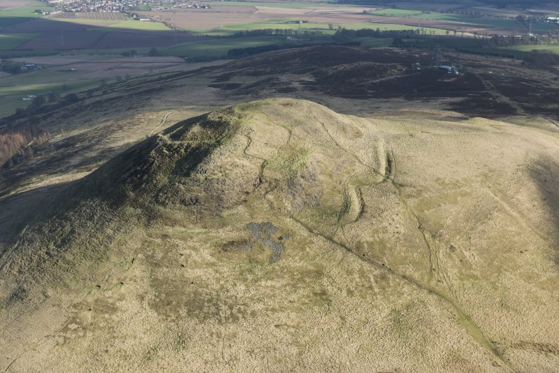 Oblique aerial view of East Lomond Hill fort, looking ENE.