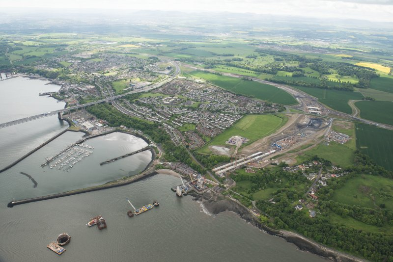 Oblique aerial view of the construction of the new Queensferry Crossing and Port Edgar, looking SE.