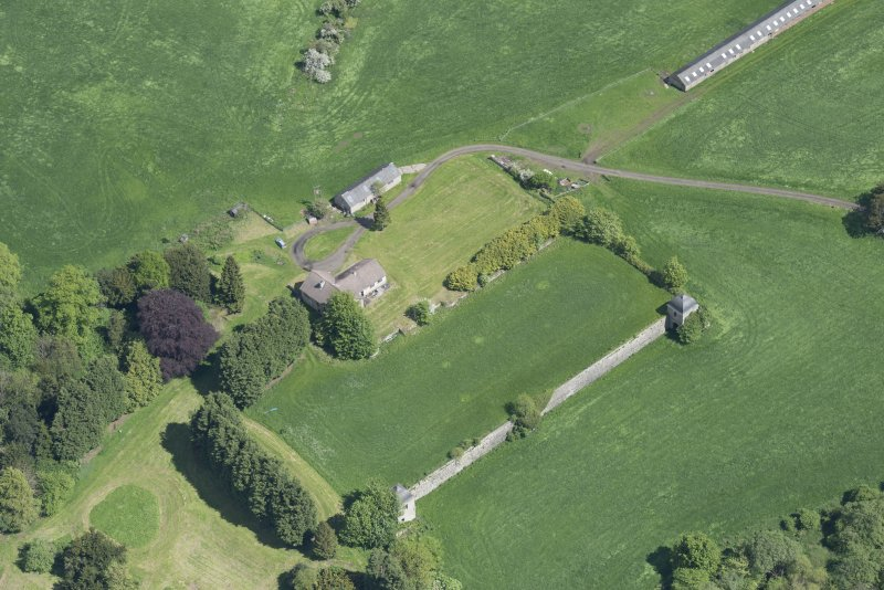 Oblique aerial view of the site of Hatton House, looking NE.