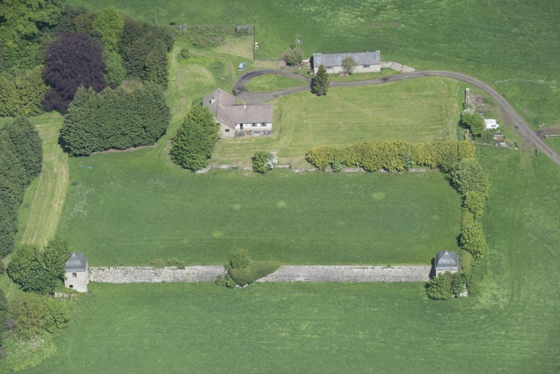 Oblique aerial view of the site of Hatton House, looking NNW.