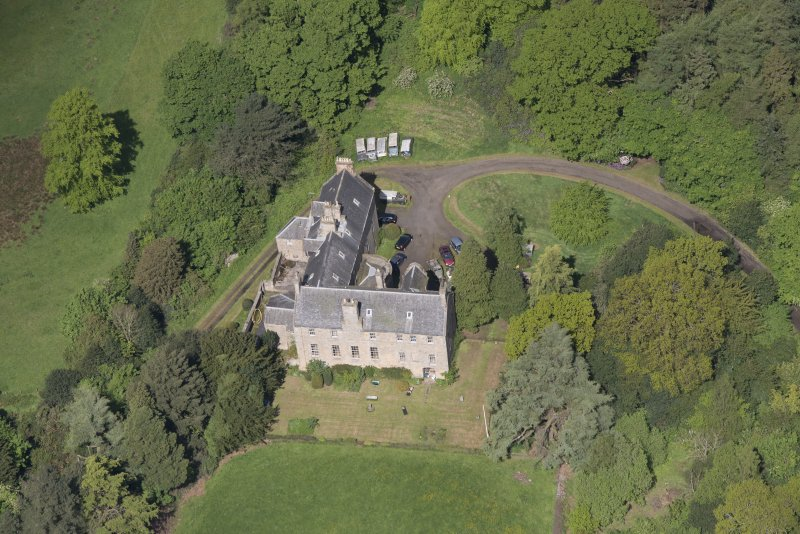 Oblique aerial view of Calder House, looking NW.