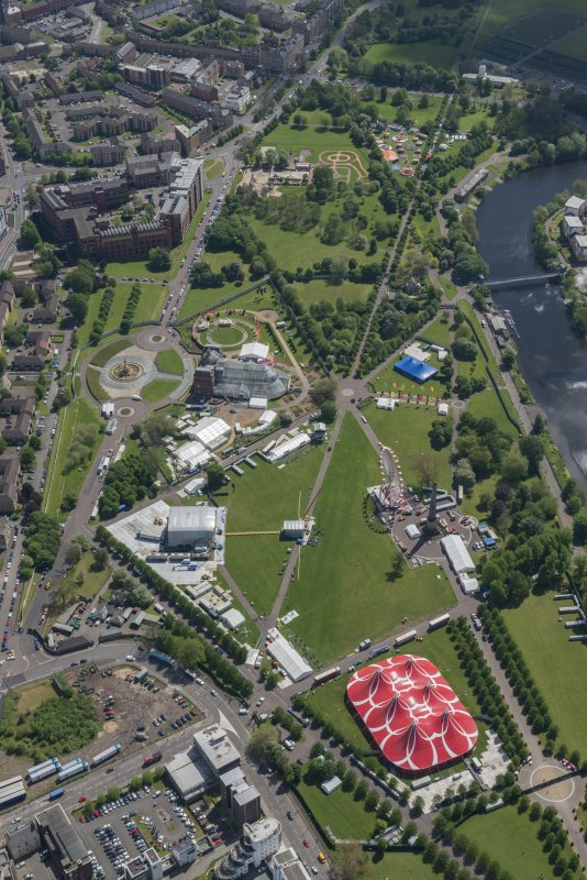 Oblique aerial view of Radio 1's Big Weekend at Glasgow Green, Nelson Monument and Peoples' Palace, looking SSE.