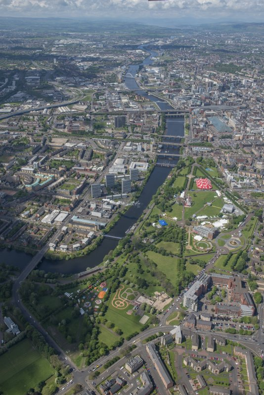 Oblique aerial view of Radio 1's Big Weekend at Glasgow Green, Nelson Monument and People's Palace, looking NW.