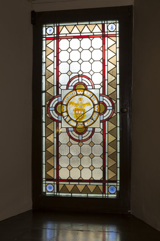 Grand staircase. Detail of stained glass window.