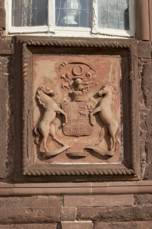 South elevation. Detail of armorial panel above doorway.