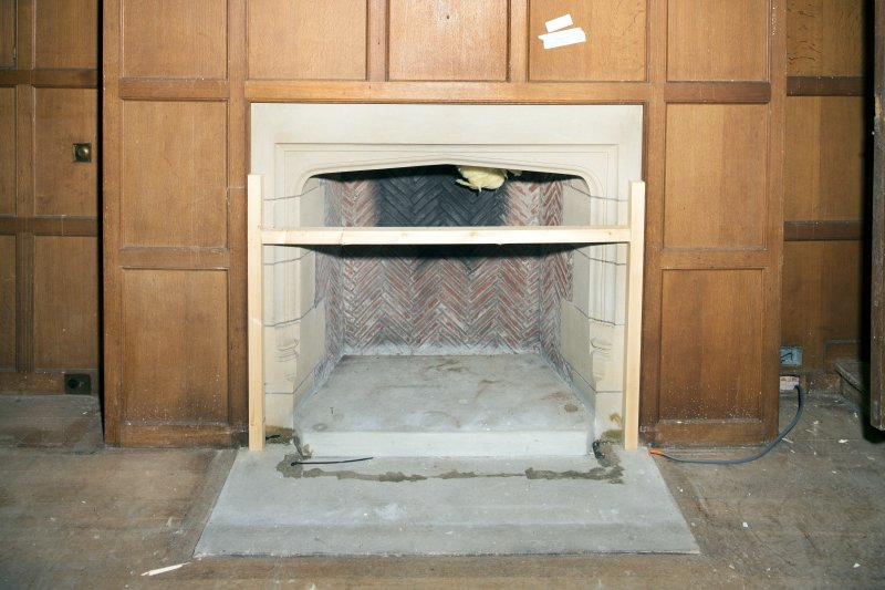 Detail of fireplace in library.