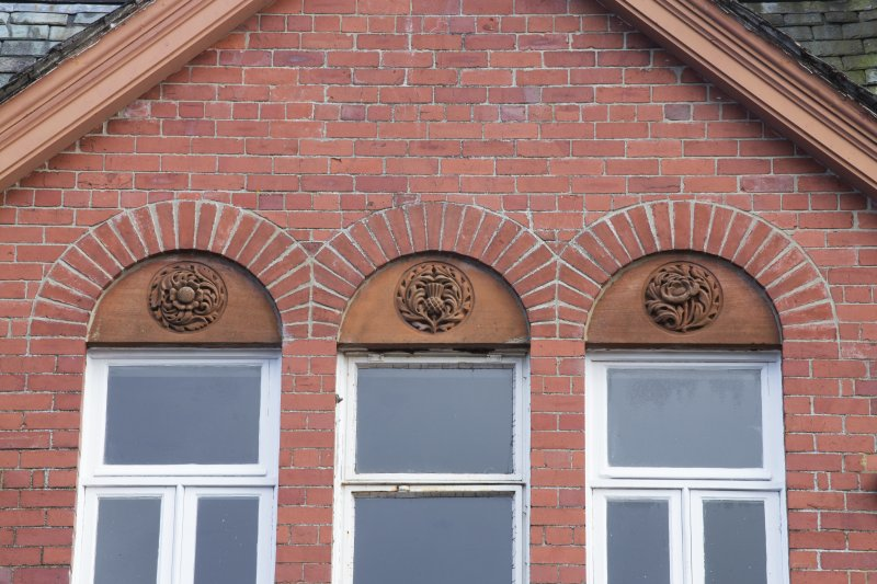 Detail of carved panels above right south facing first floor windows