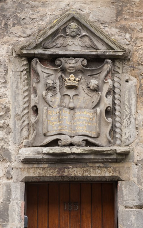 Detail of decorative panel above doorway at 185 Canongate (Bible Land), Edinburgh.