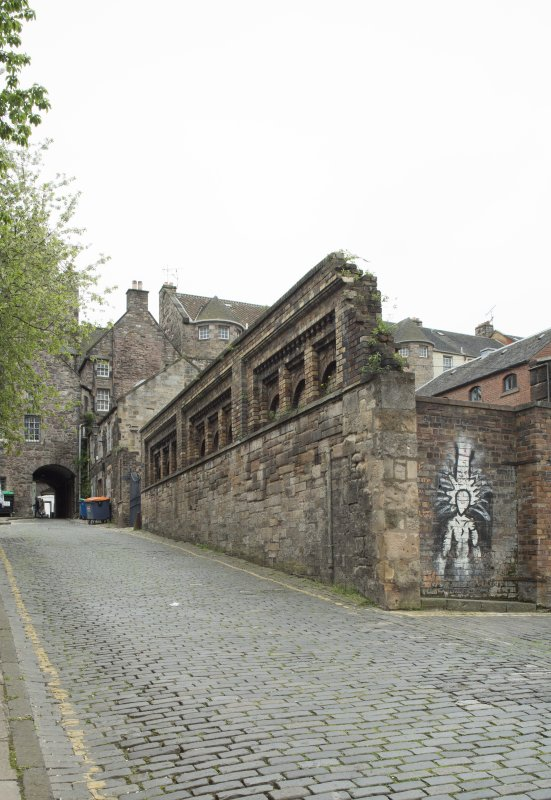 View of remnants of boundary wall of former Gas Works, Old Tolbooth Wynd, Edinburgh, from N.