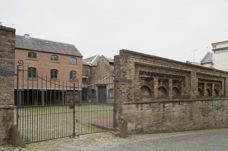 General view of former boundary wall and buildings of former Gas Works, Old Tolbooth Wynd, Edinburgh, from SE.