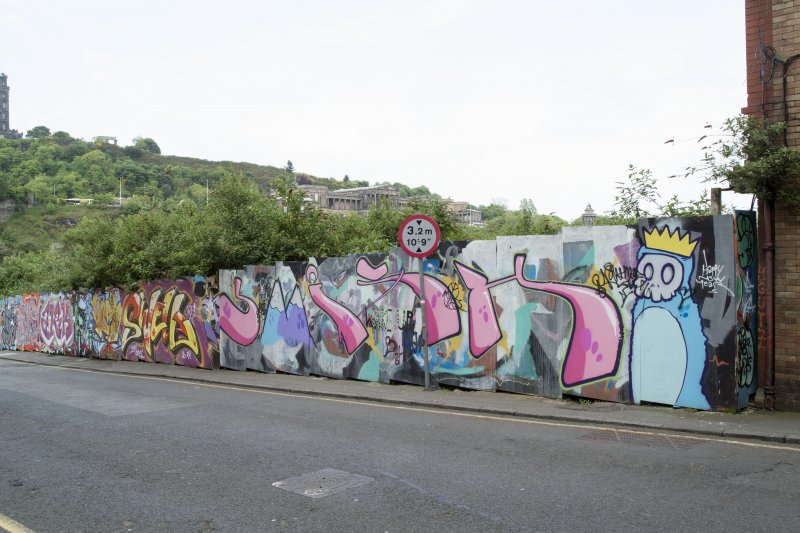 General view of graffiti art on hoardings around Caltongate Development site on New Street, Edinburgh, from N.