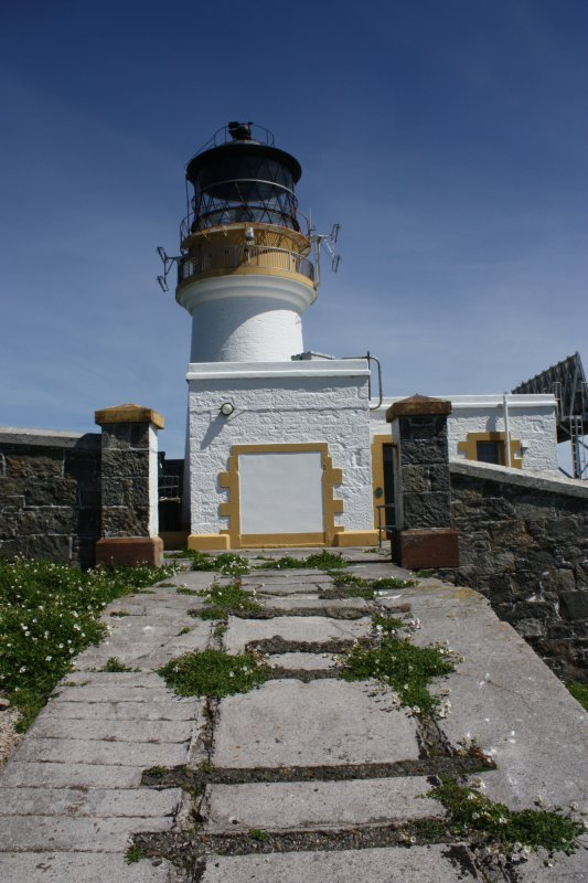 Flannan Isle lighthouse. View of tramway leading through the enclosure wall to the engine room and workshop, facing east.
