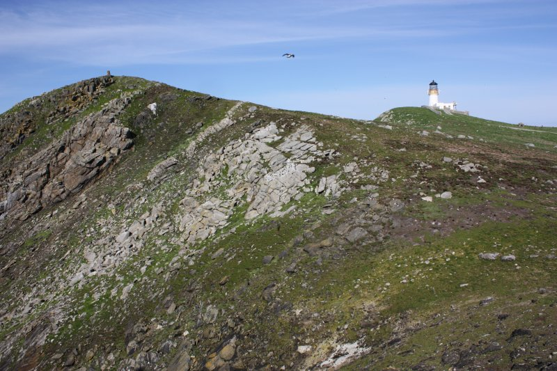 General view of Meall Meadhonach and the lighthouse, Flannan, looking E.