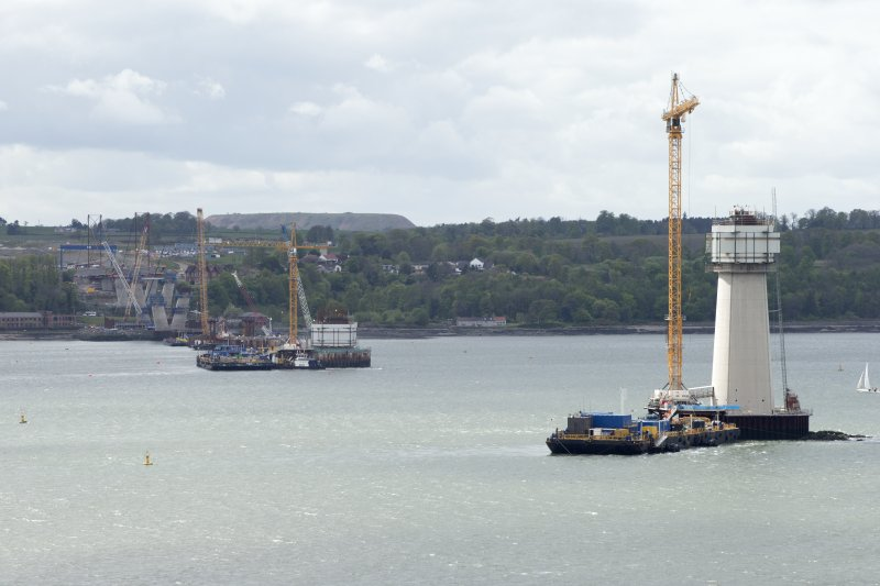 Forth crossing under construction. General view of south end of bridge and support pillars from road bridge to north east