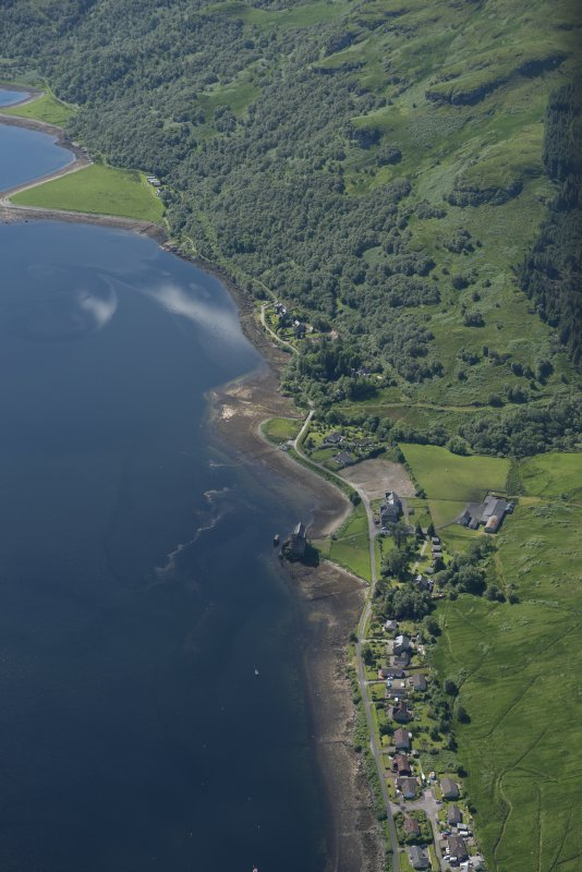 Oblique aerial view of Carrick Castle and village of Carrick, looking SSE.