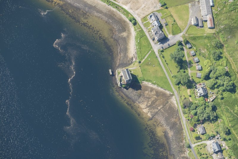 Oblique aerial view of Carrick Castle, looking S.
