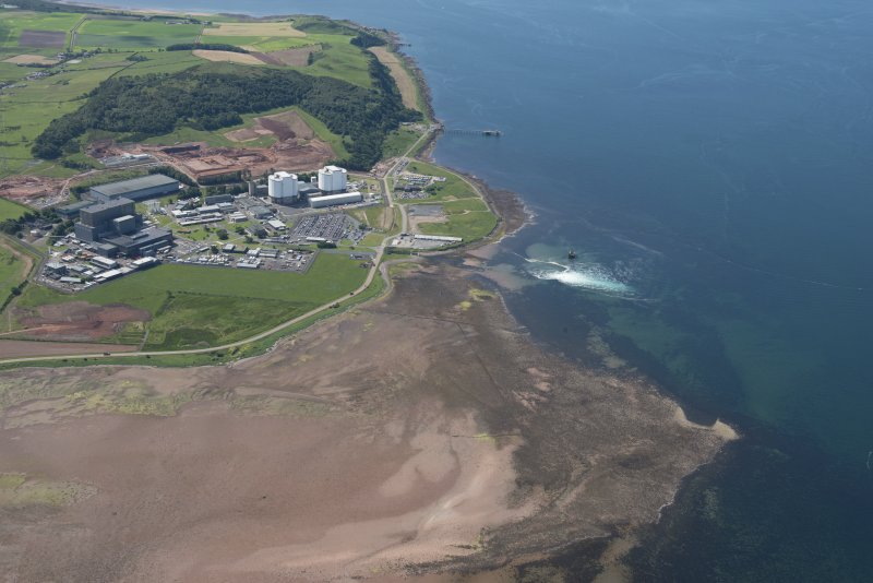 Oblique aerial view of Hunterston Nuclear Power Station, looking S.