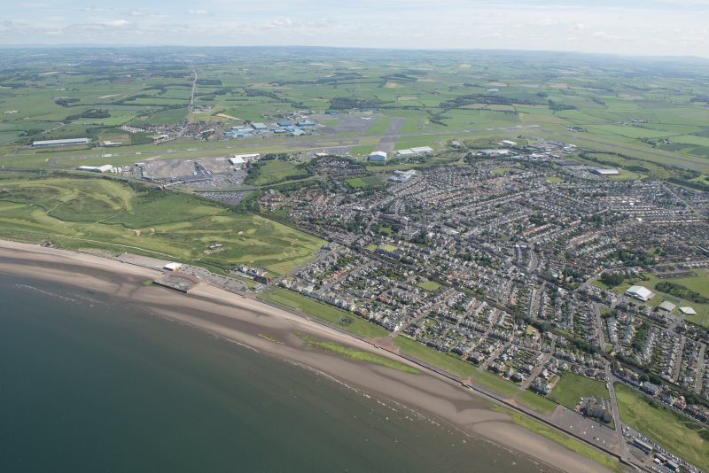 General oblique aerial view of Prestwick and Prestwick Airport, looking ENE.