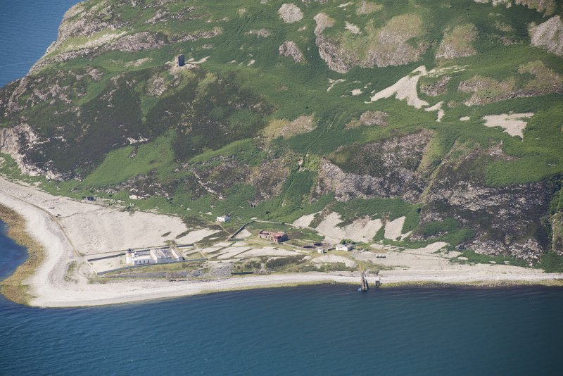 Oblique aerial view of Ailsa Craig Castle, Foreland Point Lighthouse and gasworks, looking S.