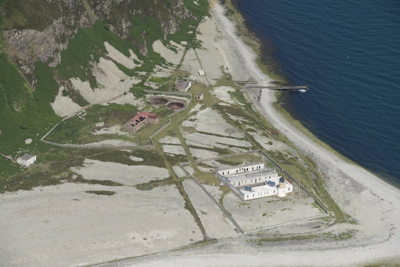Oblique aerial view of Foreland Point Lighthouse, keeper's cottages and gasworks, looking WNW.