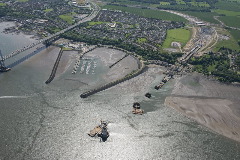 Oblique aerial view of the construction of the Queensferry Crossing and Port Edgar, looking SE.