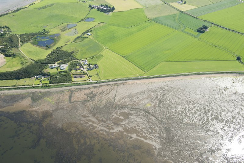 Oblique aerial view of the fish traps, looking SE.