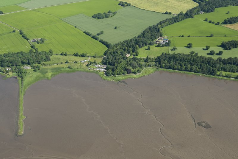 Oblique aerial view of the crannog at Redcastle, looking NNW.
