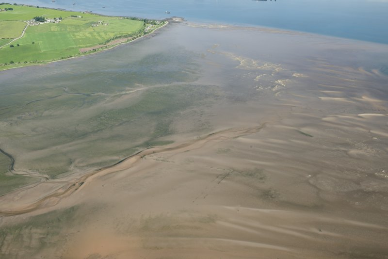 General oblique aerial view of the remains of the fish traps, looking N.