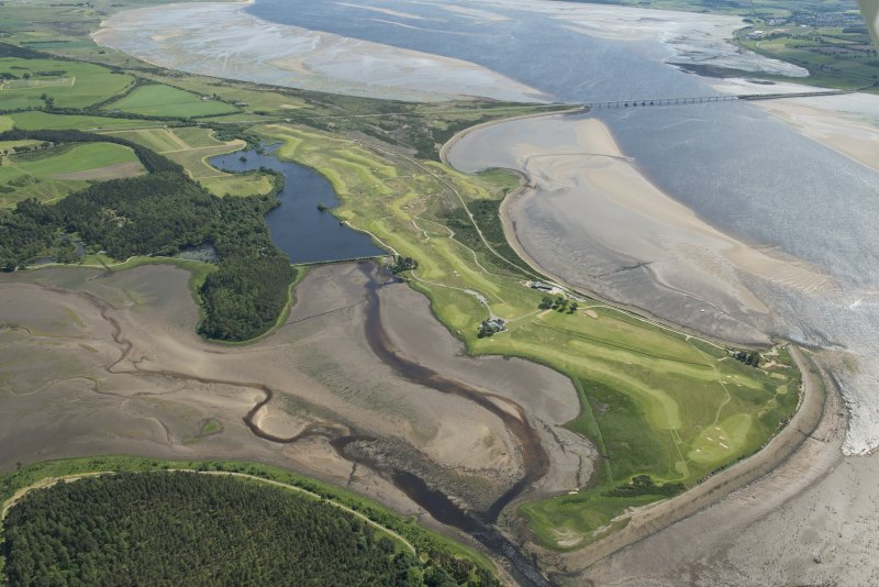 Oblique aerial view of the Carnegie Golf Course and the Meikle Ferry pier with the Dornoch Firth road bridge beyond, looking ESE.