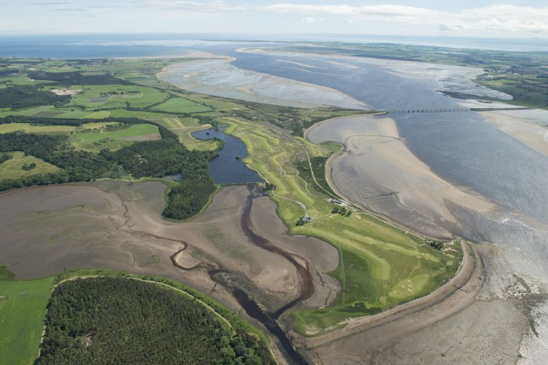 General oblique aerial view of the Carnegie Golf Course and the Meikle Ferry pier with the Dornoch Firth road bridge beyond, looking E.