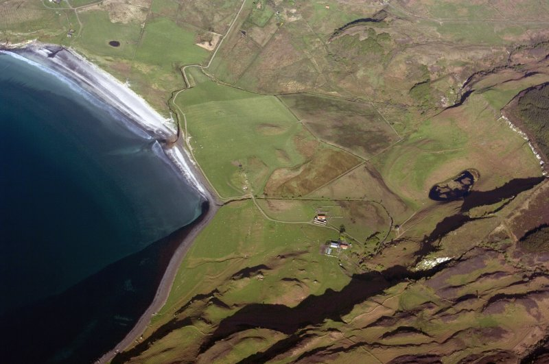 Aerial view from the SW. The farm of Laig is at lower centre with the former loch beyond it, indicated by uncultivated ground. Sròn Laimhrige (Rock of the Landing Place) is on the extreme right, above the small loch. (Colin Martin)