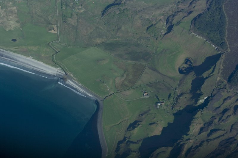 Aerial view from the SW. The farm of Laig is lower right of centre with the former loch beyond it, indicated by uncultivated ground. Sròn Laimhrige (Rock of the Landing Place) is at top right, above the small loch. (Colin Martin)