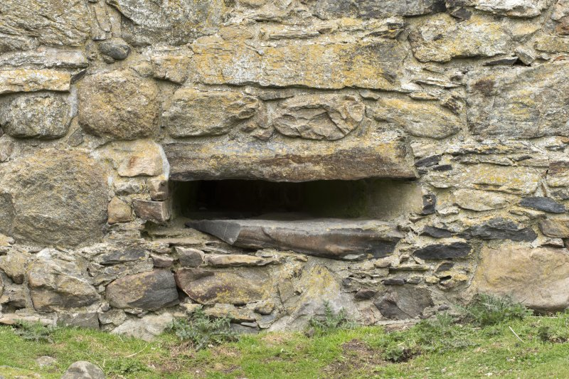 Invermark Castle. Basement, detail of horizontal slit window opening at west end of south face