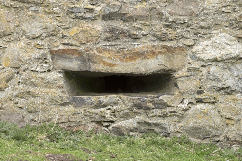Invermark Castle. Basement, detail of horizontal slit window opening at east end of south face