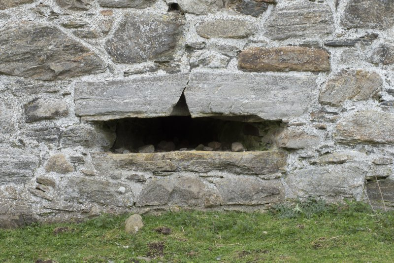 Invermark Castle. Basement, detail of horizontal slit window opening at east end of north face