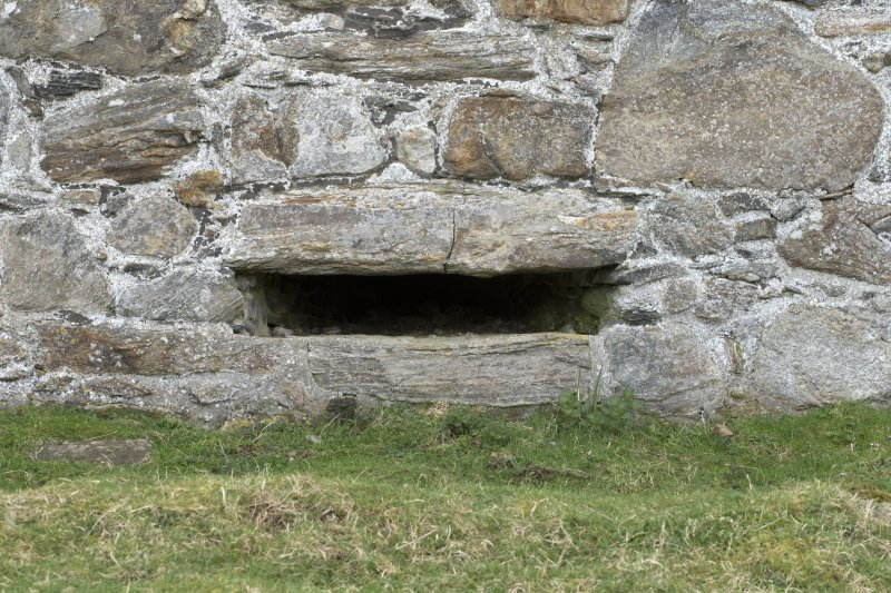 Invermark Castle. Basement, detail of horizontal slit window opening in centre of north face