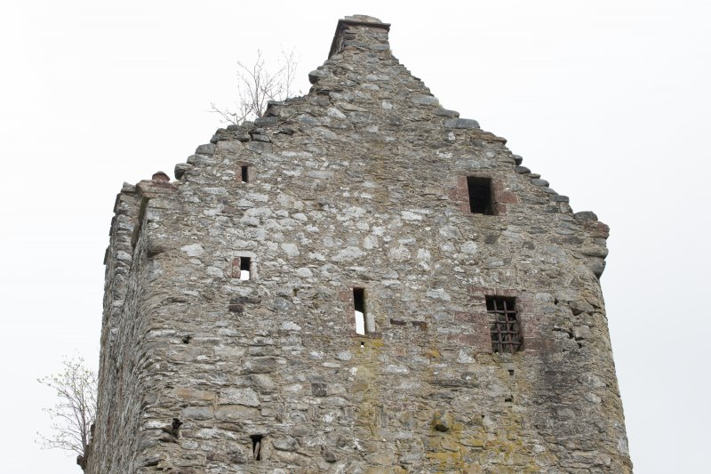 Invermark Castle. View of roof line and upper windows on west face