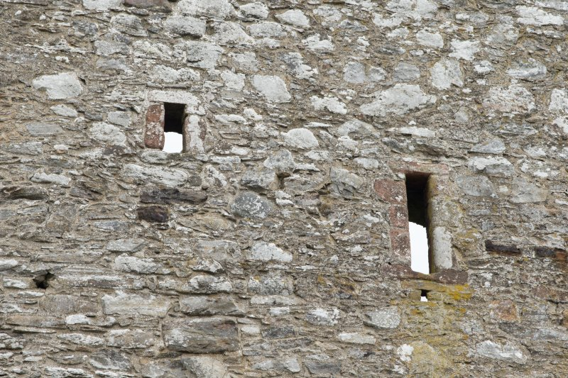 Invermark Castle. Detail of two slit windows at 3rd floor level of west face