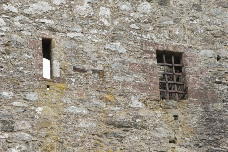 Invermark Castle. Detail of slit window and larger window with yett at 3rd floor level of west face