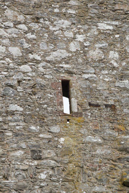 Invermark Castle. Detail of small slit window at 3rd floor level of west face