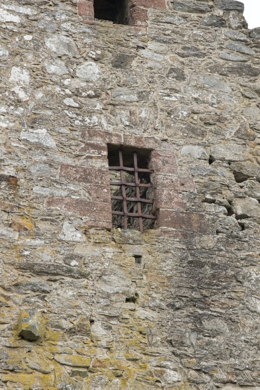 Invermark Castle. Detail of window opening with yett at 3rd floor level of west face