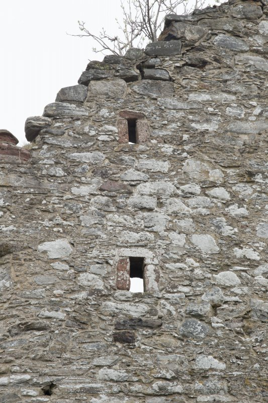 Invermark Castle. Detail of two small slit windows at 3rd and attic levels of west face