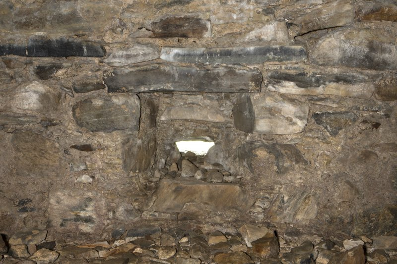 Invermark Castle. Basement, detail of inside of horizontal slit window in centre of north face
