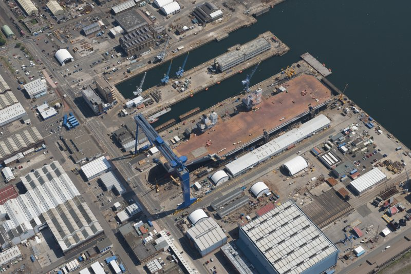 Oblique aerial view of the building of the aircraft carrier, HMS Elizabeth at Rosyth Dockyard, looking SSE.