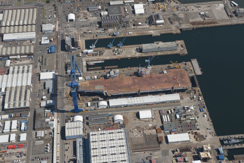 Oblique aerial view of the building of the aircraft carrier, HMS Elizabeth at Rosyth Dockyard, looking SE.