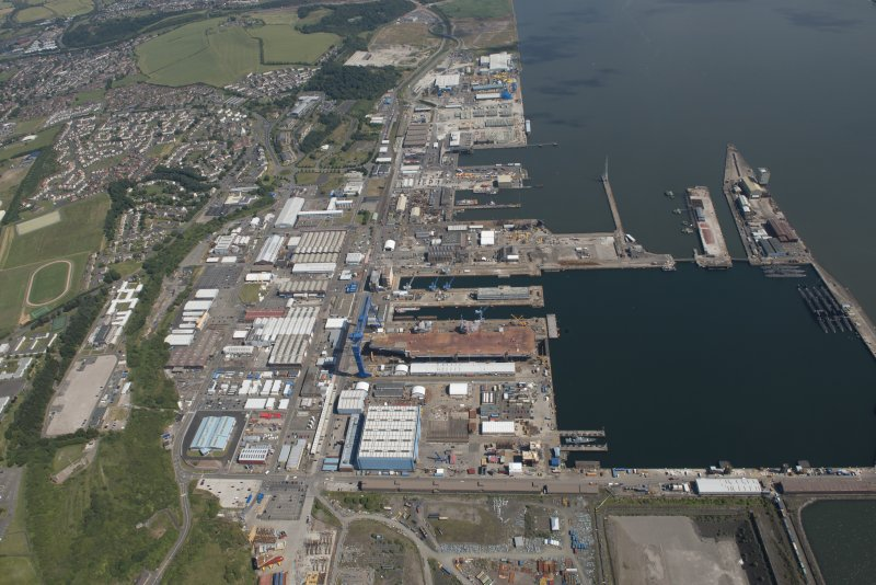 Oblique aerial view of the building of the aircraft carrier, HMS Elizabeth at Rosyth Dockyard, looking ESE.