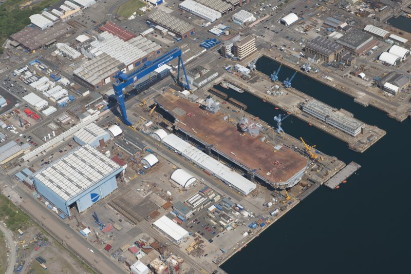 Oblique aerial view of the building of the aircraft carrier, HMS Elizabeth at Rosyth Dockyard, looking E.
