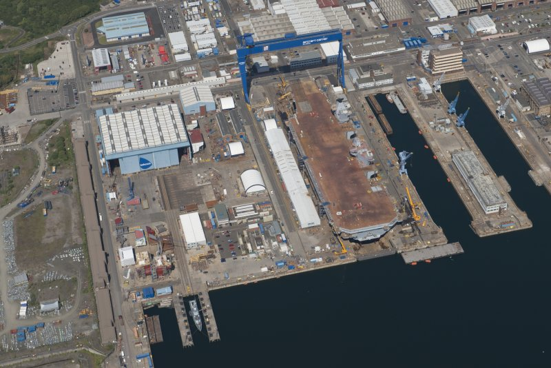 Oblique aerial view of the building of the aircraft carrier, HMS Elizabeth at Rosyth Dockyard, looking NE.