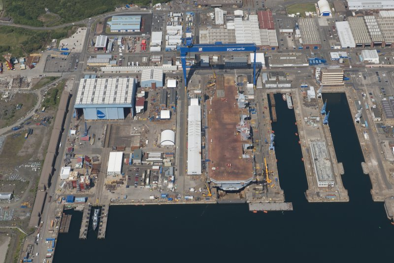 Oblique aerial view of the building of the aircraft carrier, HMS Elizabeth at Rosyth Dockyard, looking N.