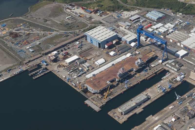Oblique aerial view of the building of the aircraft carrier, HMS Elizabeth at Rosyth Dockyard, looking NW.
